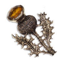 Large gold plated single thistle brooch Topaz